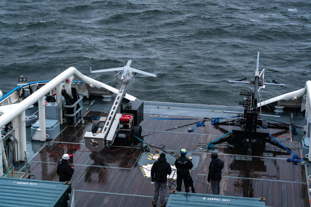 Unmanned aircraft ready to launch at the deck of a vessel.